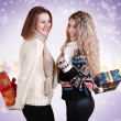 Two girlfriends with chrisnmas presents - Photo