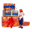 Little funny gnome near gift boxes — Stock Photo