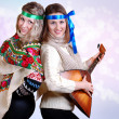 Two russibeauty girls with folk attributes — Stock Photo #14545661