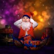 Worried little gnome with gift boxes — Stock Photo