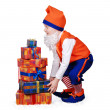 Stock Photo: Funny gnome with christmass presents