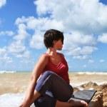 Woman in half spinal twist yoga pose — Stock Photo