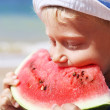 Boy eating watermelon — Stock Photo #14545765