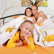 Happy family in bedroom — Stock Photo