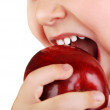 Healthy baby teeth bite ripe red apple — Stock Photo