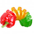 Multicolored paprika sliced like slinky toy - Stock Photo