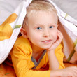 Sweet little boy in bed — Stock Photo #14546091