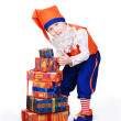Funny little christmas elf with gift box — Stock Photo