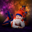 Smiling little gnome with gift boxes — Stock Photo #14547481