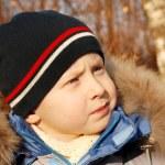 Cute boy's portrait at the autumn park — Stock Photo