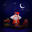 Gnome with gifts at the New Year midnight — Stock Photo #14547499