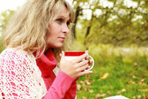 Woman with cup of hot tea in outdoor — Stock Photo