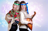 Two russian beauty girls with folk attributes — Stock Photo