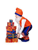 Funny gnome with christmass presents — Stock Photo