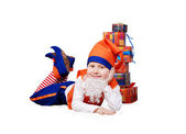 Funny gnome with presents — Stock Photo