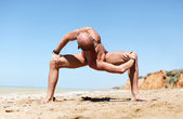 Man in strong spinal twist yoga pose — Stock Photo