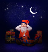 Gnome with gifts at the New Year midnight — Stock Photo