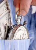 Cronometro con soldi in tasca — Foto Stock