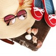 Straw hat wit red shoes on old suitcase — Stock Photo