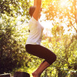 Woman doing yoga at the park — Stock Photo #14564661