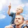 Son at father's shoulders — Stock Photo #14564713