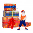 Little funny gnome with gift boxes — Stock Photo