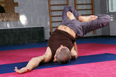 Yoga teacher in gymnasium — Stock Photo