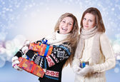 Two girlfriends with christmas presents — Stock Photo