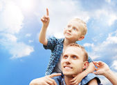 Son at father's shoulders — Stock Photo