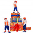Three posing gnomes with gift boxes — Stock Photo