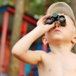 Little boy looks in binoculars — Stock Photo #14617369