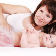 Stock Photo: Mother with infant daughter