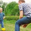 Son and father play in football — Stock fotografie