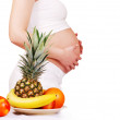 Fuits and pregnant tummy — Stock Photo