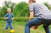 Son and father play in football — Stock Photo
