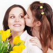 Stock Photo: Daughter kissing mother