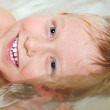 Portrait of little boy bathing - Stock Photo