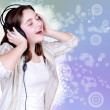 Stock Photo: Portrait of singing cute teenage girl in headphones