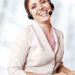 Happy smiling call center operator — Stock Photo
