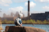 Industrial landscape with playing boy — Stock Photo