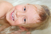 Portrait of little boy bathing — Stock Photo