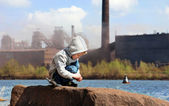 Industrial landscape with little boy — Stock Photo