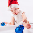 Pretty little girl  in Santa's hat — Stock Photo