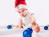 Pretty little girl in Santa's hat — Stock Photo