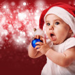 Pretty baby in christmas hat — Stock Photo