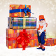 Pretty little gnome with chrismas gifts — Stock Photo