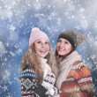 Two happy beautiful girls winter portrait - Stock Photo