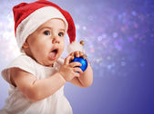 Pretty baby girl in christmas hat — Stock Photo