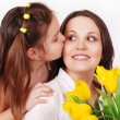 Daughter kissing mother — Stock Photo #15432885