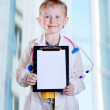 Stock Photo: Little doctor with clip board
